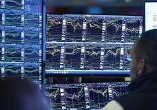 Specialist Anthony Matesic works at his post on the floor of the New York Stock Exchange, Monday, Oct. 18, 2021. Stocks wobbled in midday trading on Wall Street Monday as the market's momentum slows following its best week since July. (AP Photo/Richard Drew)