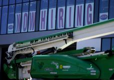 A hiring sign is displayed at a furniture store window on Friday, Sept. 17, 2021, in Downers Grove, Ill. Unemployment claims dropped 6,000 to 290,000 last week, the third straight drop, the Labor Department said Thursday, Oct. 21, 2021,. That's the fewest people to apply for benefits since March 14, 2020, when the pandemic intensified. (AP Photo/Nam Y. Huh)