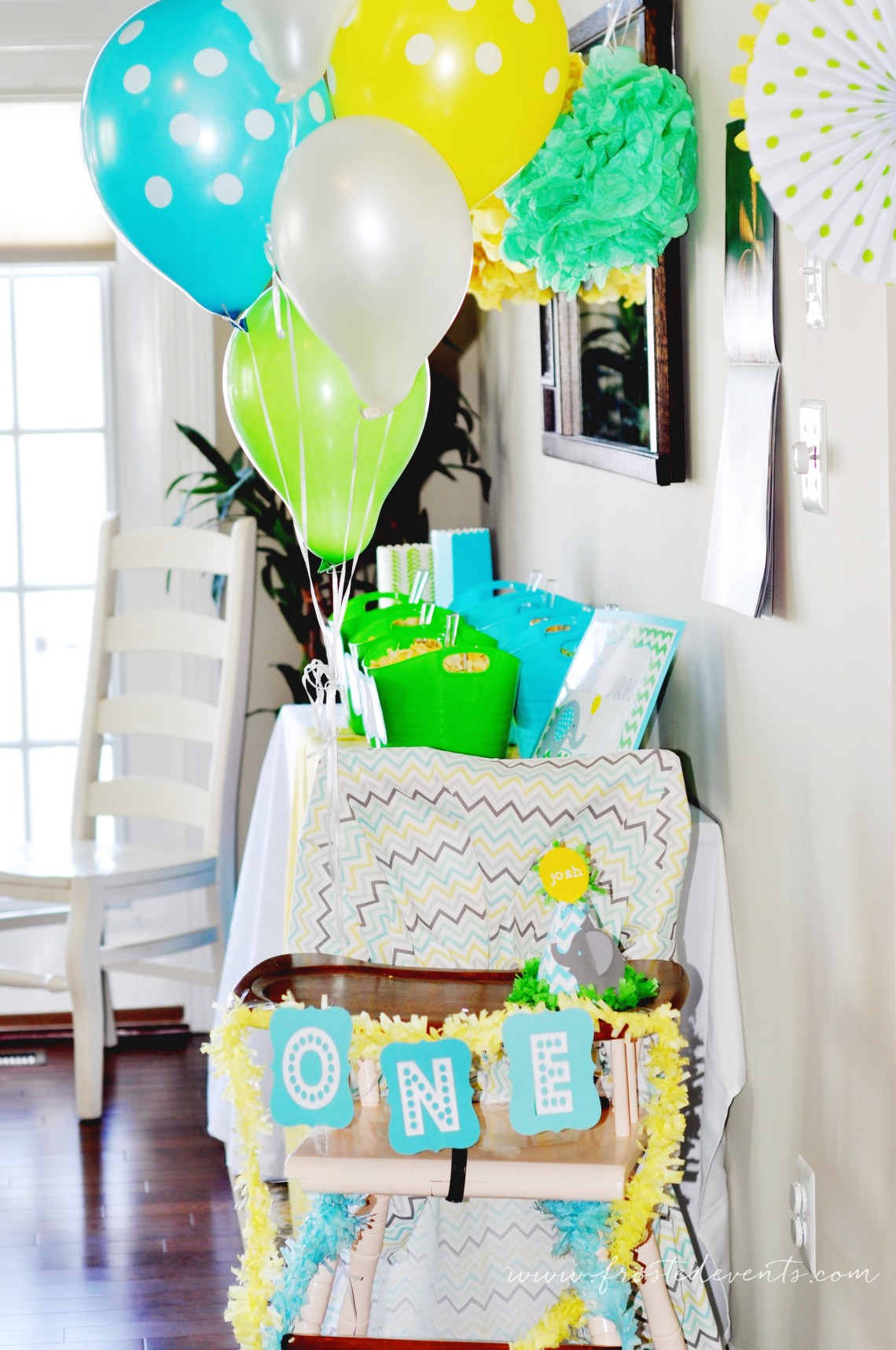First Birthday Party Ideas - A Bright and Fun First Birthday Party for Little Boy Blue Green Elephant Theme via frostedevents.com @frostedevents