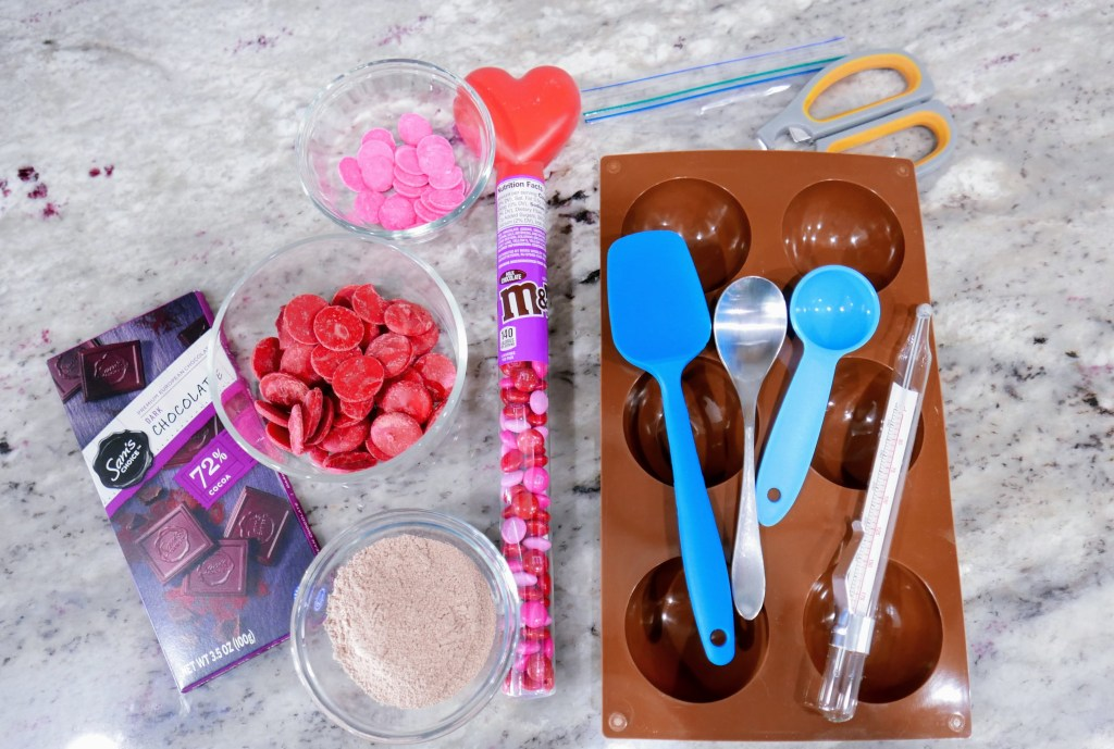 ingredients and tools for hot chocolate bombs