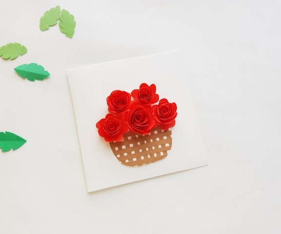 paper flower bouquet with basket on white paper