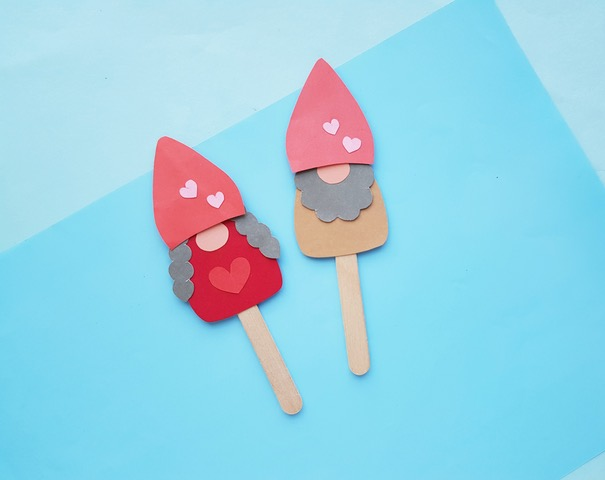 two gnome papercraft puppets on popsicle sticks