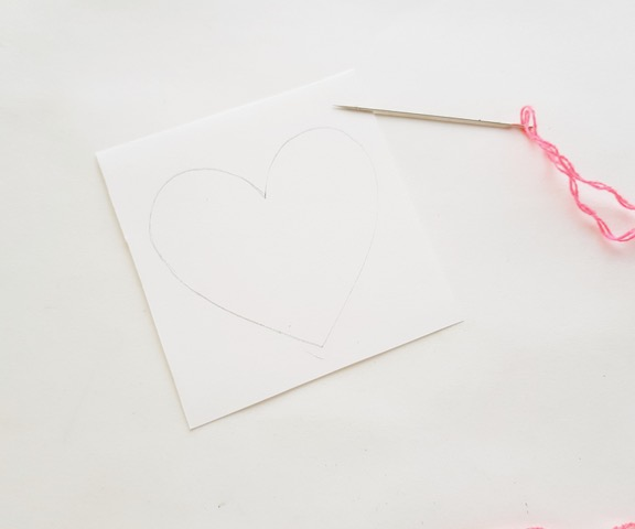 step one of how to make a heart stitch carft