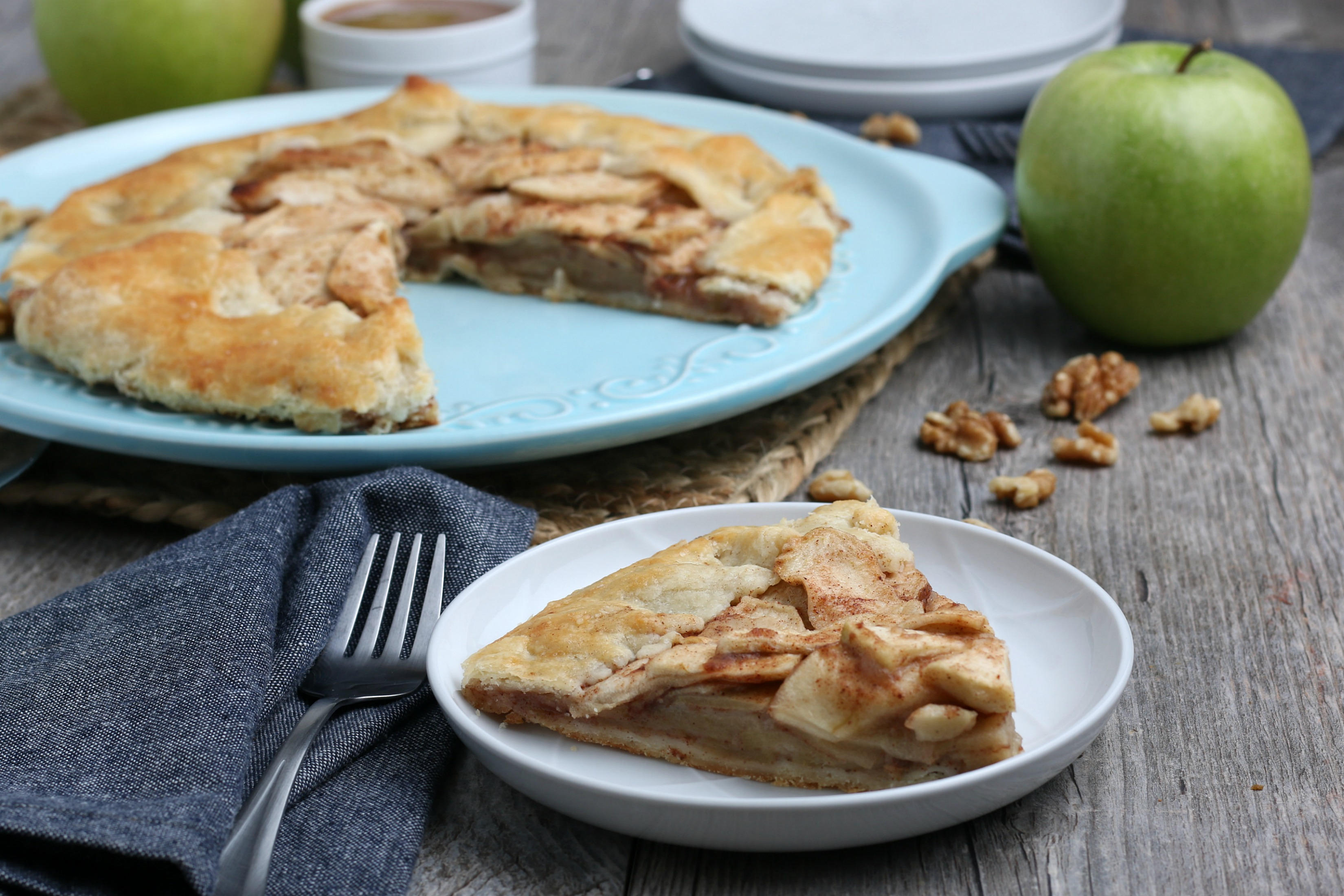 slice of apple crostata on a glass white plate