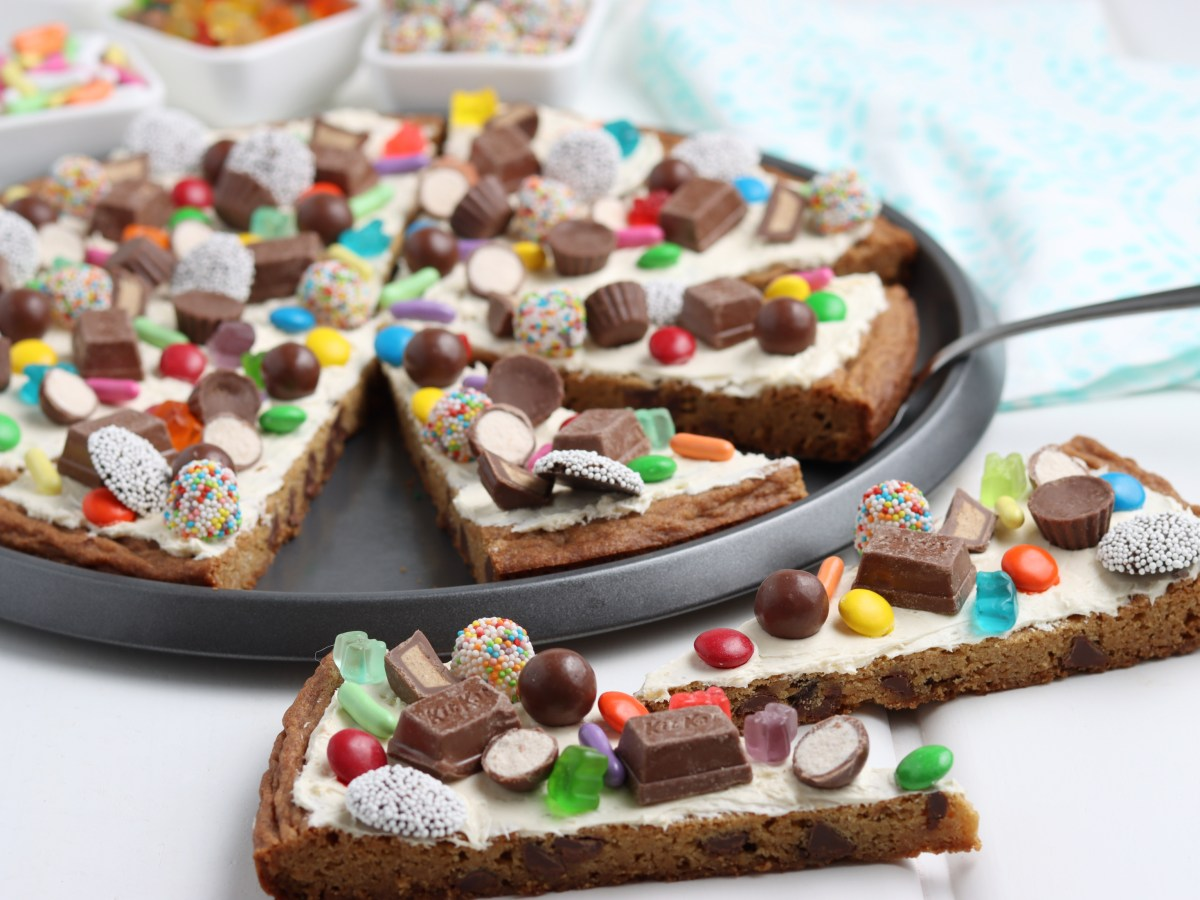 easy cookie pizza recipe covered in candy pieces