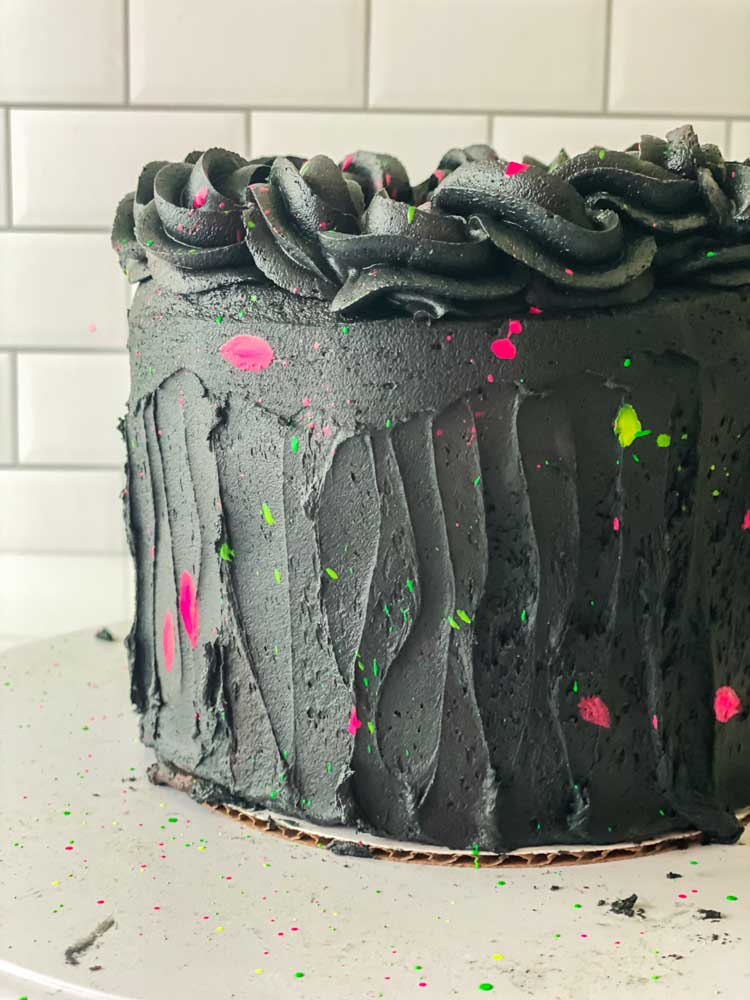 glow in the dark cake with black frosting and splatters