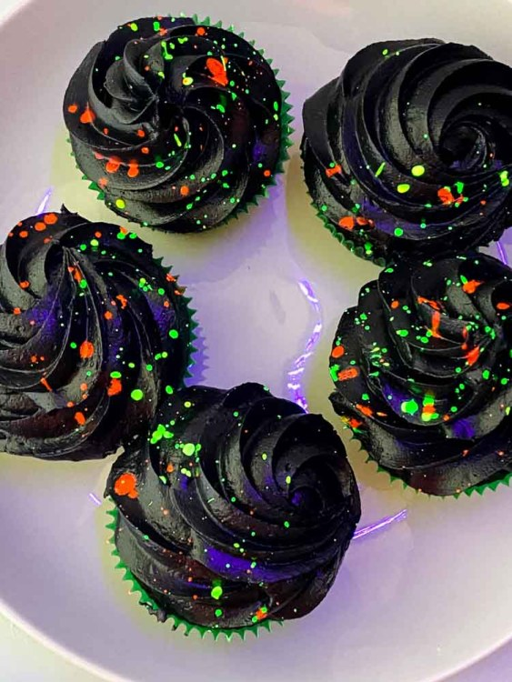 glow in the dark cupcakes on a round white plate