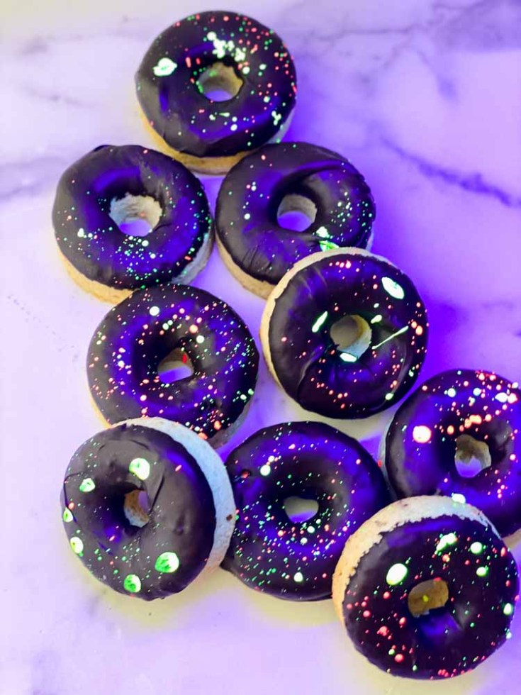 glow party donuts pile sitting on a marble countertop