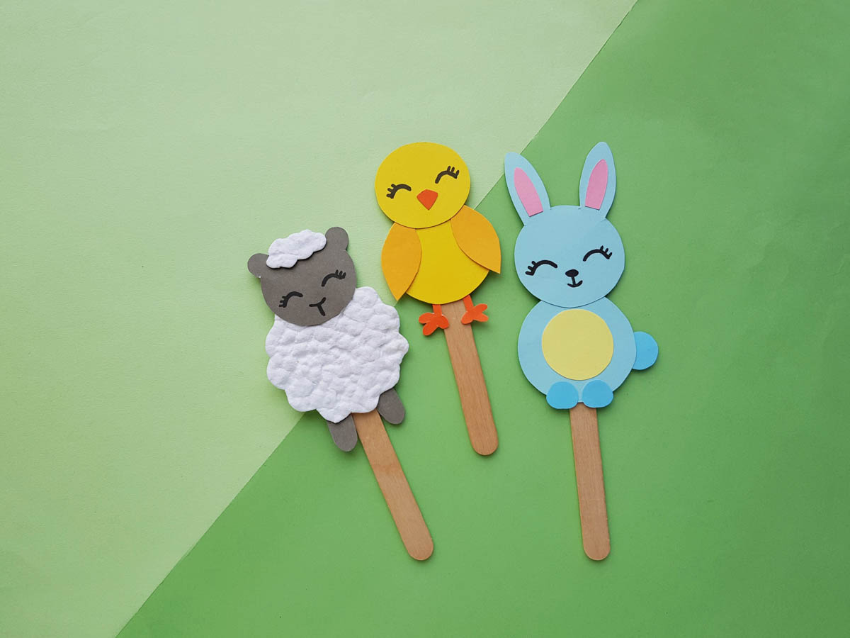 Lamb Chick and bunny paper puppets on green background