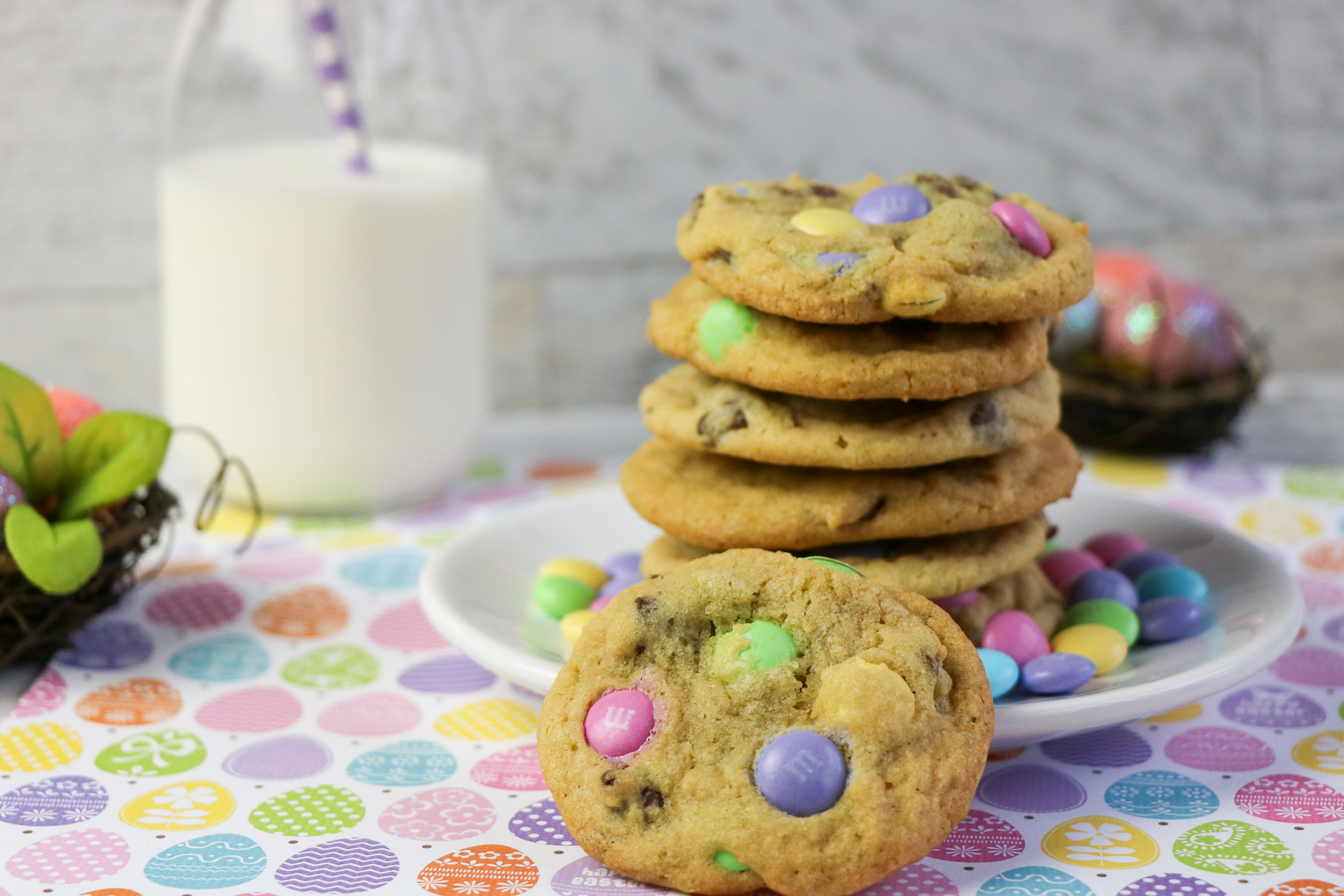 easter m&m cookies with glass of milk and straw