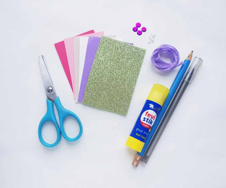 Supplies needed to make a mixed media mermaid craft.