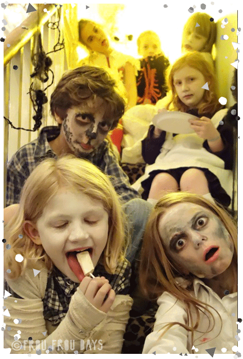 Halloween kids dressed up on the stairs