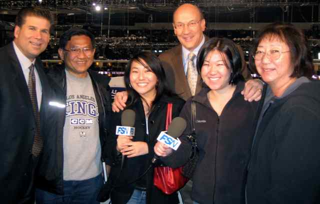 """Los Angeles Kings fan Stacy Iwata (third from left) and her family visit with """"Voice of the Kings"""" Bob Miller and Jim Fox in the broadcast booth. Photo courtesy Stacy Iwata"""