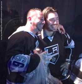 Defenseman Drew Doughty poses for a photo with a fan