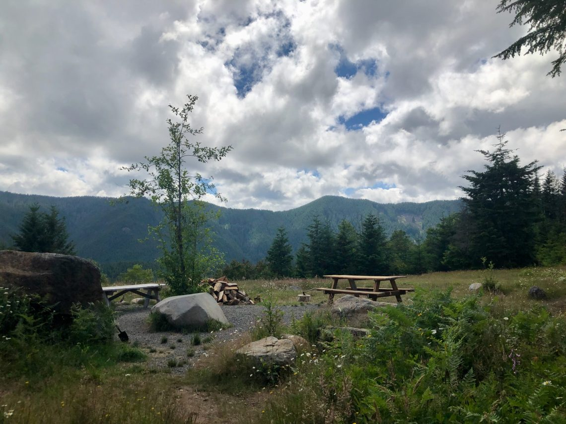 Campsite with picnic and prep table with view of forest hills. Hipcamp reviews Enola Hill