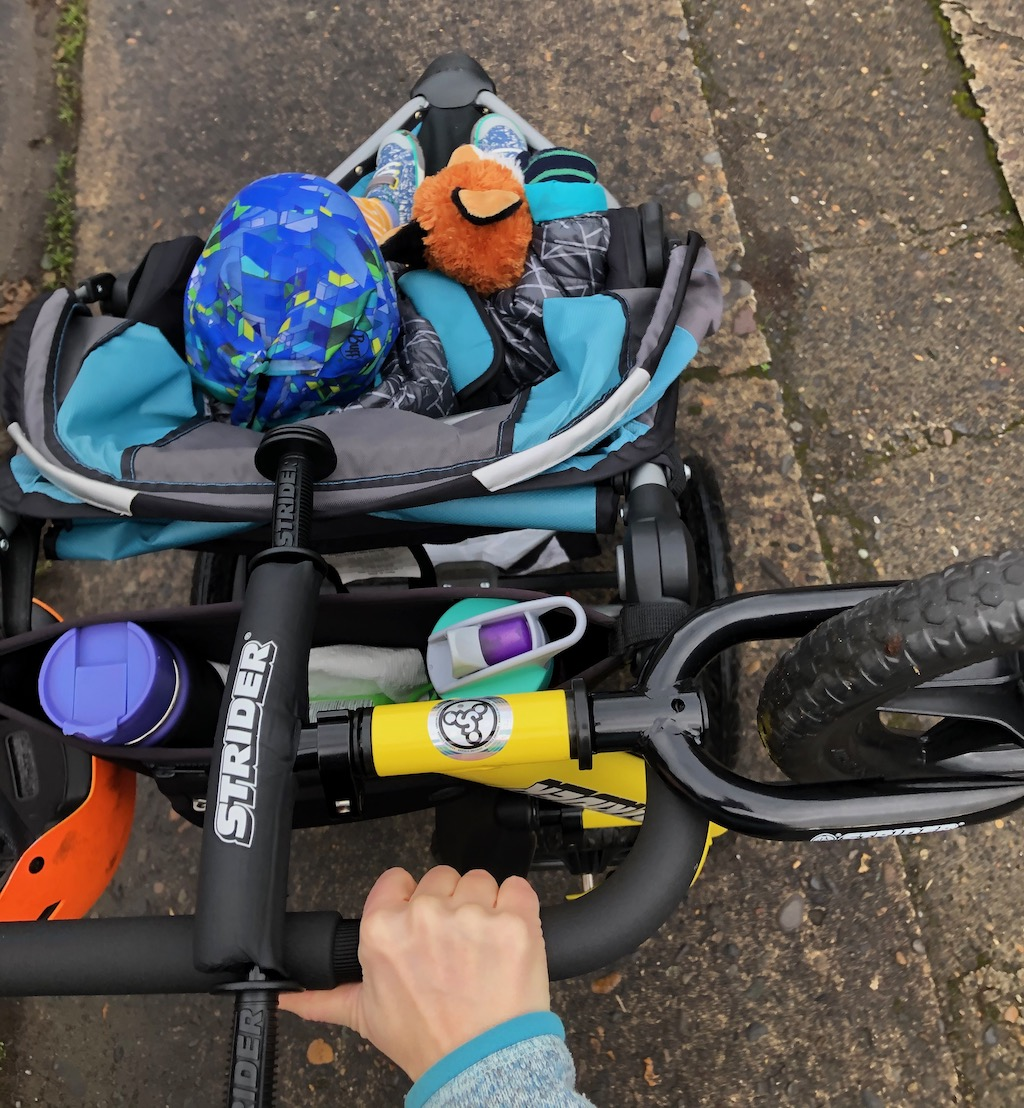 how to fit a balance bike on a stroller
