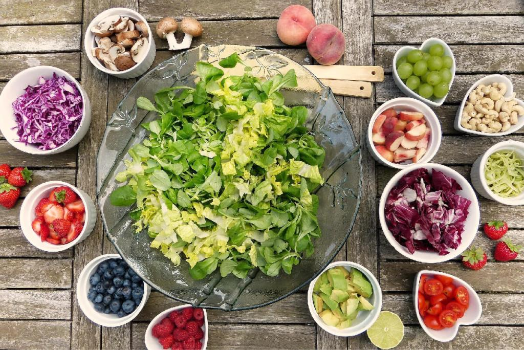 Bowls of vegetables and fruits that are ready to be mixed into a salad is analogous to mixing financial securities to become an index fund.