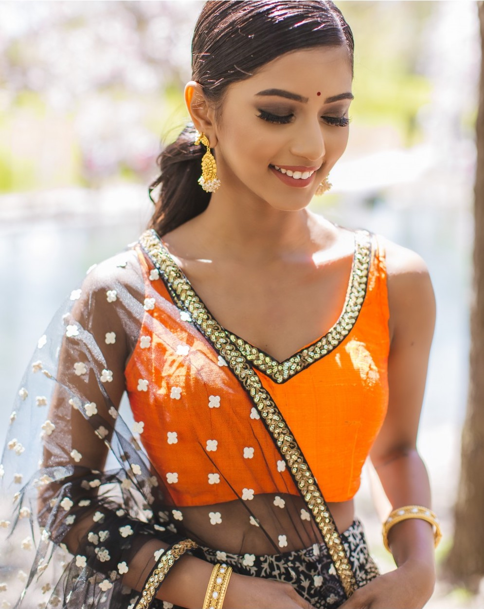 Orange Crop Top Black Lehenga
