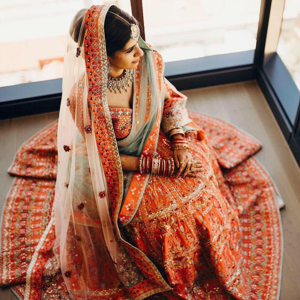 Anita Dongre Orange wedding lehenga