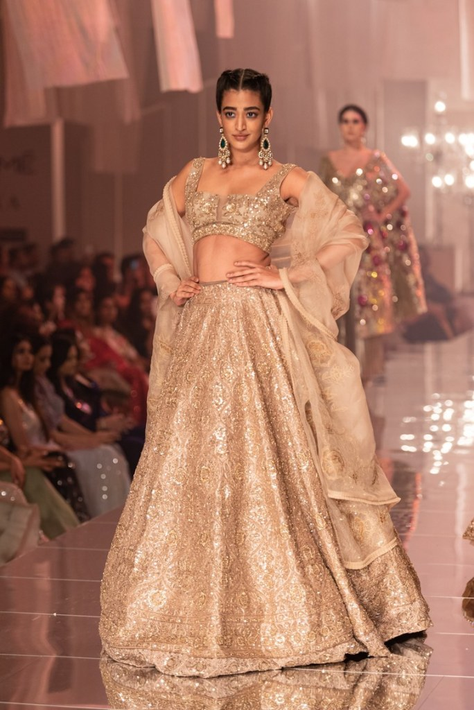 Gold Lehengas, Sarees, and Gowns by Manish Malhotra