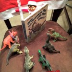 Elf on the Shelf Reads a Book