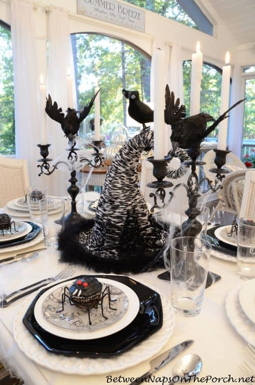 Halloween-Tablescape-with-Spider-Cupcakes-Clock-Plates-a-Witchs-Hat-Centerpiece-crow-naps-porch