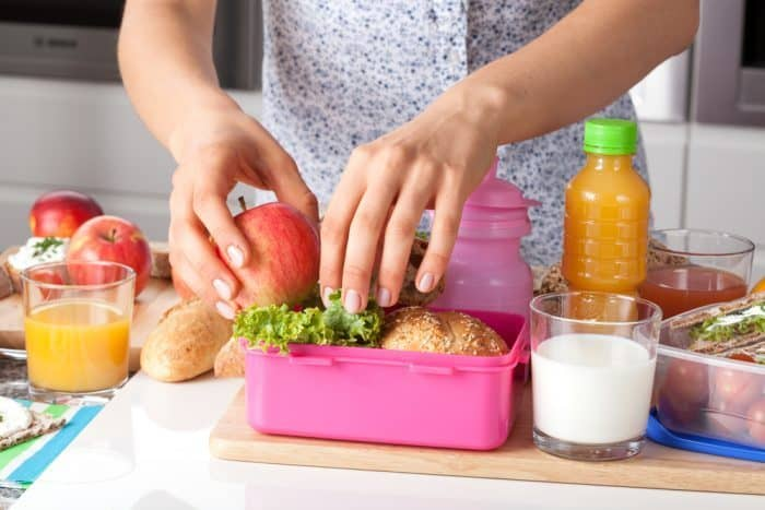 Lunch Box Ideas or Kids - Mother Packing a Lunch Box