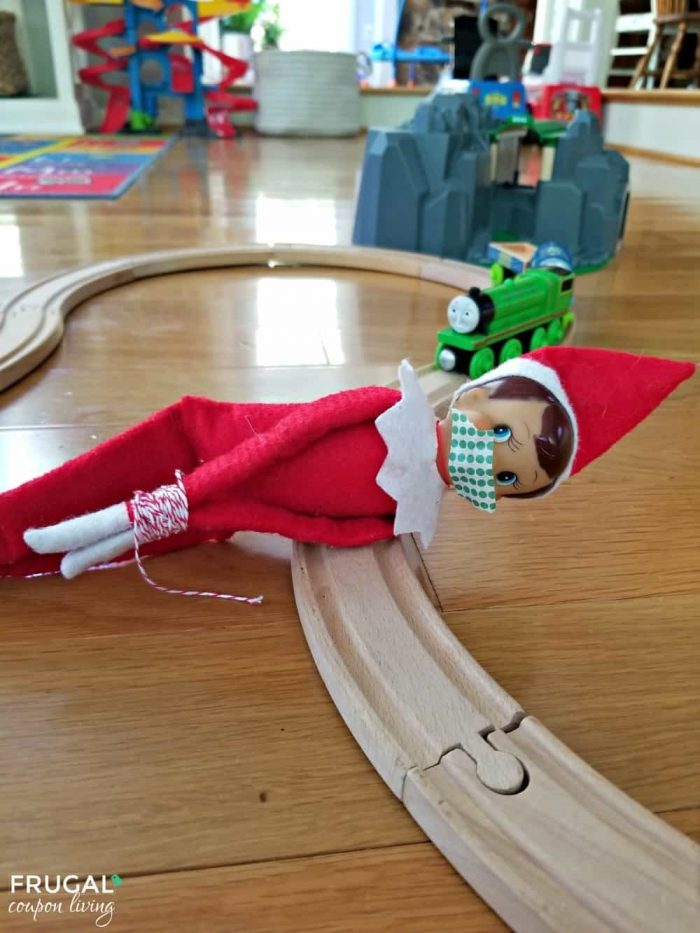 Elf on the Shelf Train Track Idea | Elf is Tied Up to Wooden Tracks