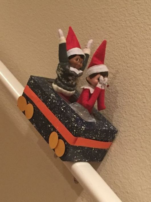 Elf on the Shelf Ideas with Boxes | Kleenex Box Sled on the Stairs