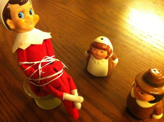 Thanksgiving Elf on a Shelf Ideas | Elf Tied Up by Pilgrims