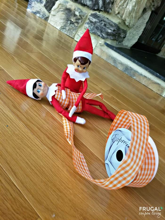 Elf on the Shelf Ideas for Multiple Elves - Scout Elves at Play Rolled Up in Craft Ribbon