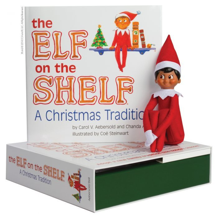 brown elf on the shelf doll siting on elf on the shelf book
