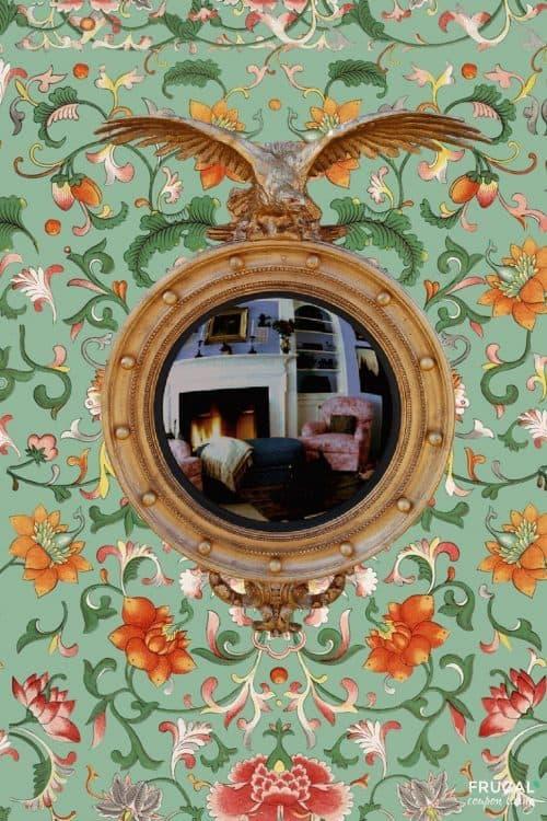 Grandmillennial Eagle Convex Accent Mirror is on green floral wallpaper