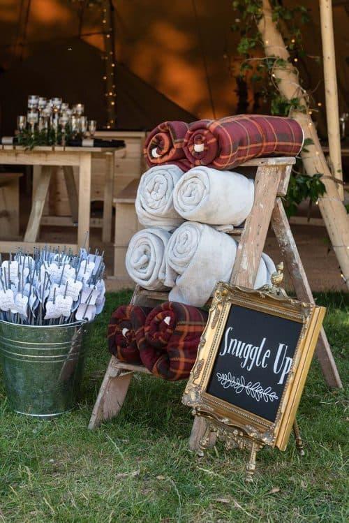 Cheap Outdoor Wedding Decor Ideas | Snuggle Up Blanket Display