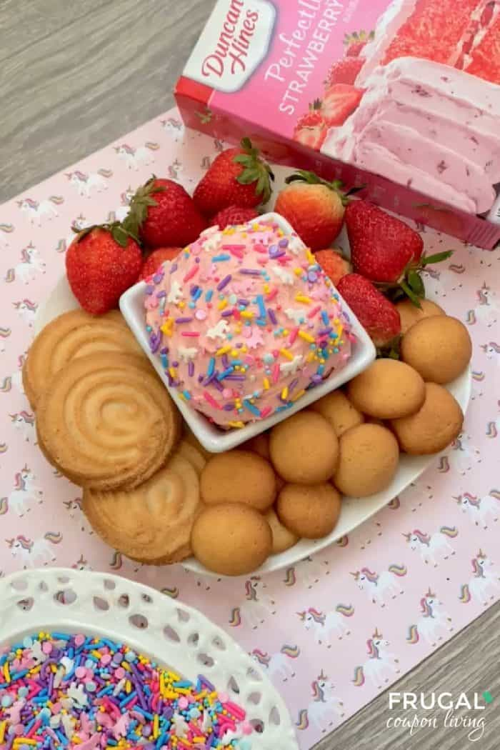 display of strawberry cake mix dip with cookies and unicorn sprinkles