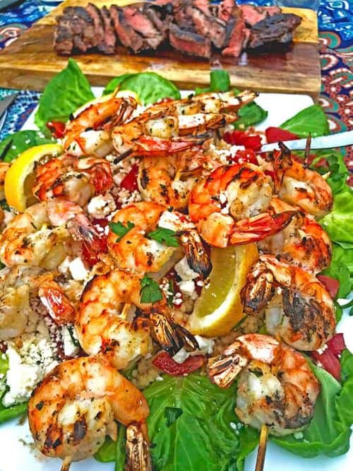 Greek-Style Grilled Shrimp on a Dish with Greens
