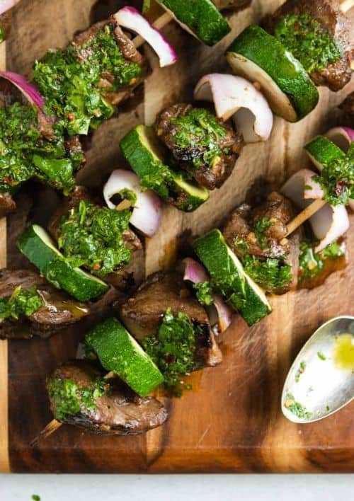 Grilled Steak Kabobs with Cilantro Chimichurri on a wooden board with a spoon