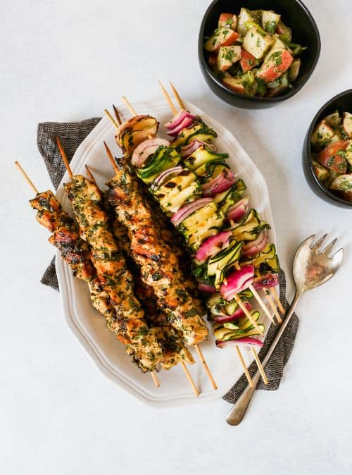 Triple Herb Healthy Chicken Recipe and Zucchini Skewers on white dish