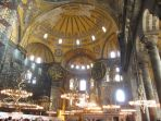 domed interior of Hagia Sophia with lights