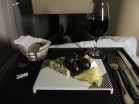 Square plate of cheeses with a glass of French Bordeaux