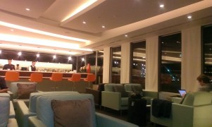 Etihad Airways guest lounge seating area with bar at Sydney Airport