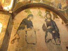 mosaic of Mary and Joseph in need of repair