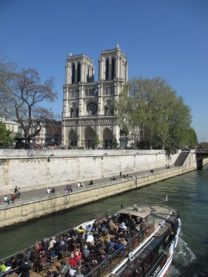River Seine with cruise boat and Notre Dame in the background