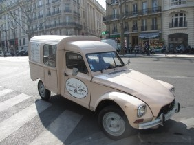 Pink 2CV delivery van parked on a street in Paris