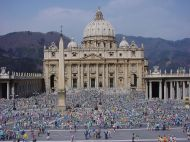 St Peters Square and exterior of St Peter's Basilica with large crowds