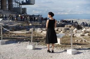beautiful girl in black posing at the Acropolis