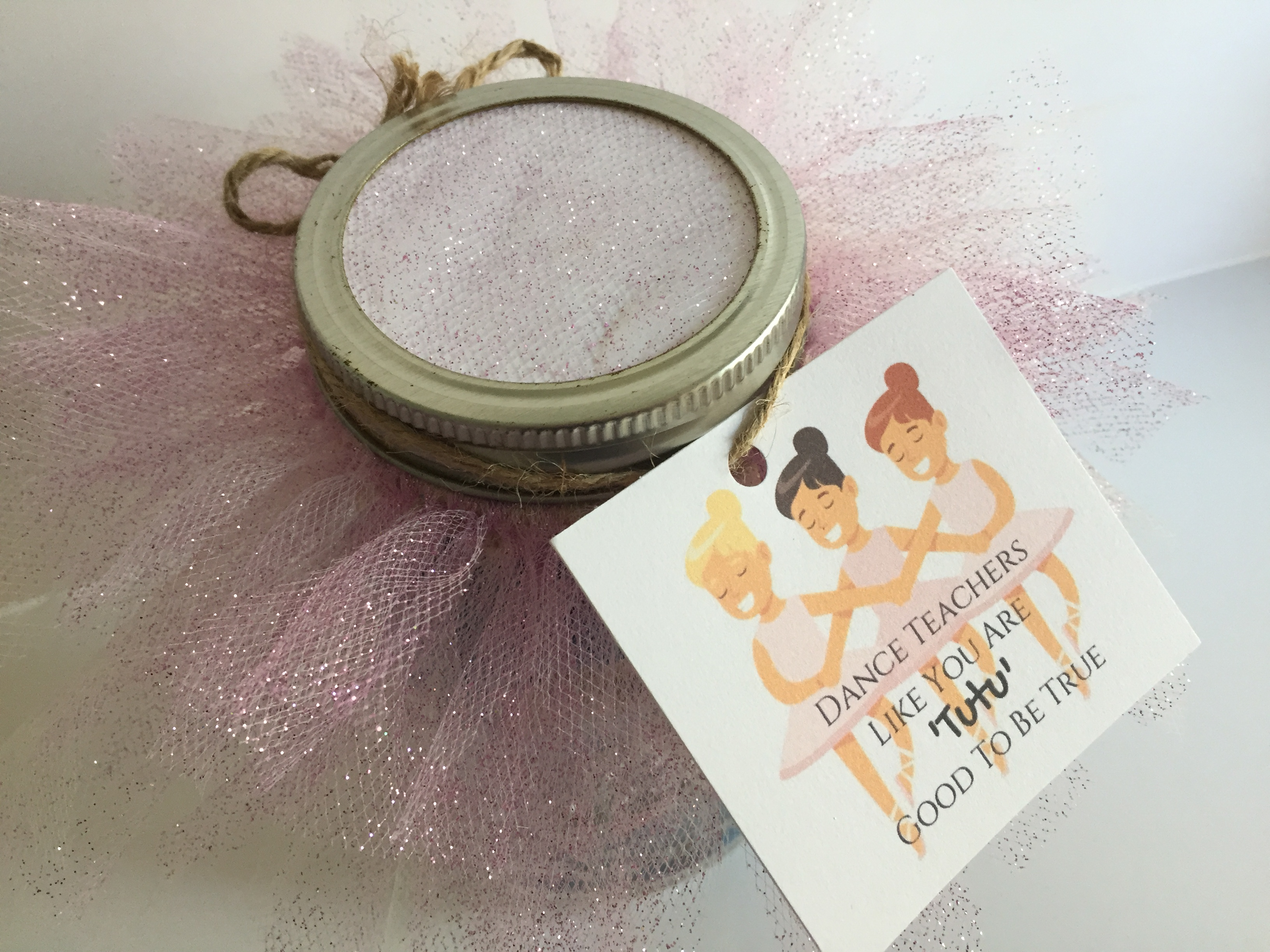"""Jar with candy covered in pink tulle with gift tag that reads """"Dance teachers like you are 'tutu' good to be true"""" - Tutu-riffic Gifts For Dancers & Dance Teachers With Printable Gift Tags"""