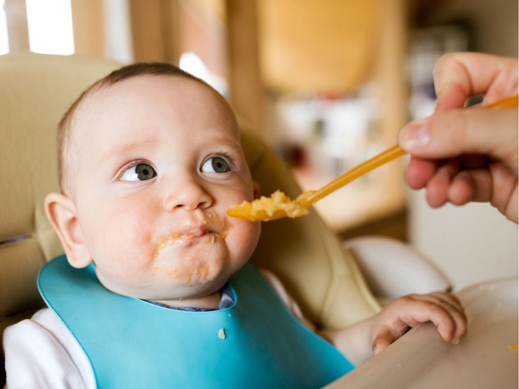 Baby being fed baby food - What Corporate Managers & Stay-At-Home Moms Have In Common