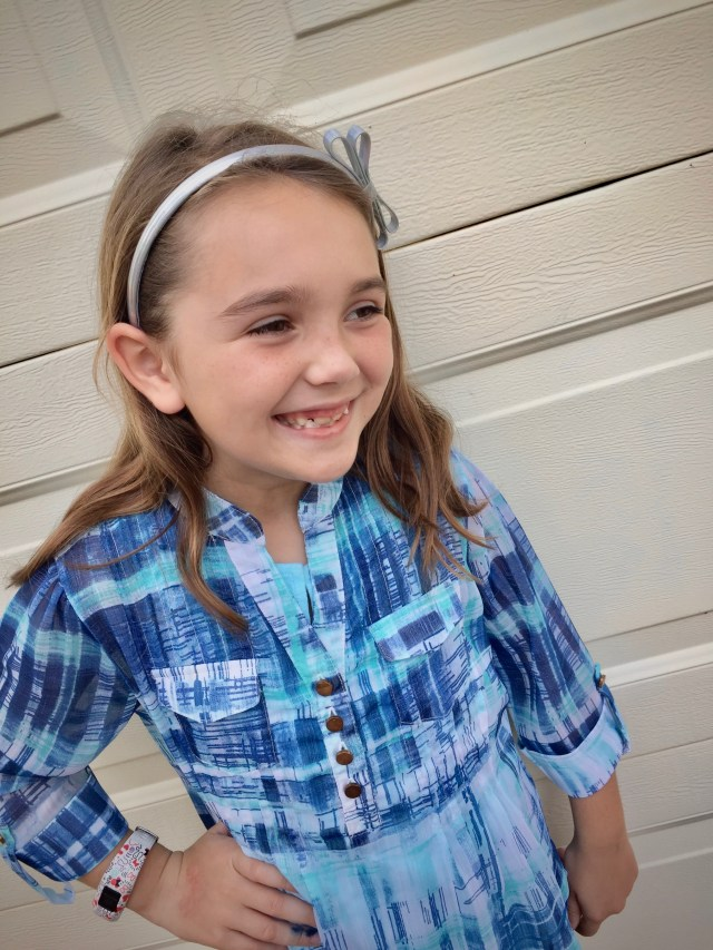 Girl smiling in blue top - This Frugal Mom's Favorite Subscription Box