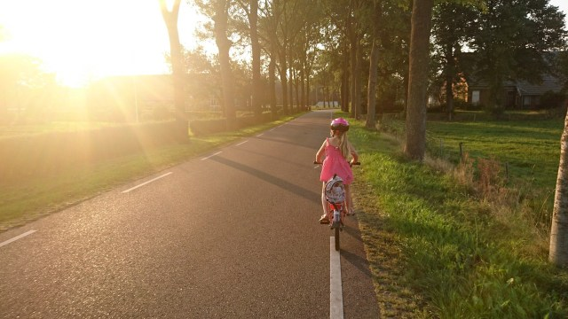 Girl riding a bike - Giant List Of Family Activities For A No-Spend Weekend